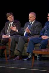 Flanked by officials with the U.S. Air Force and the FAA,  retired U.S. Navy Capt. Gary Foster explains how U.S. nuclear forces readied in response to the 9/11 attacks ten years ago. Foster made the remarks Friday, September 09, 2011, at a memorial panel