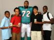 Miami Dolphins' Offensive Lineman Vernon Carey (#72) with students from Driftwood Middle School in Hollywood, Florida.