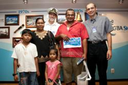 Mahavishnu Veerasingam and his family with Captain Tom Dyer (USA) and Ship Director Gian Walser (Switzerland) who presented him with gifts as the two millionth visitor to Logos Hope since her launch into ministry in February 2009. © OM Ships International