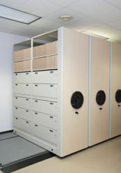 Datum combined three different MobileTrak5® Systems equipped with 4Post™ Shelving to create a custom storage solution