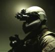 A soldier wears the Batlskin Head Protection System with night vision equipment
