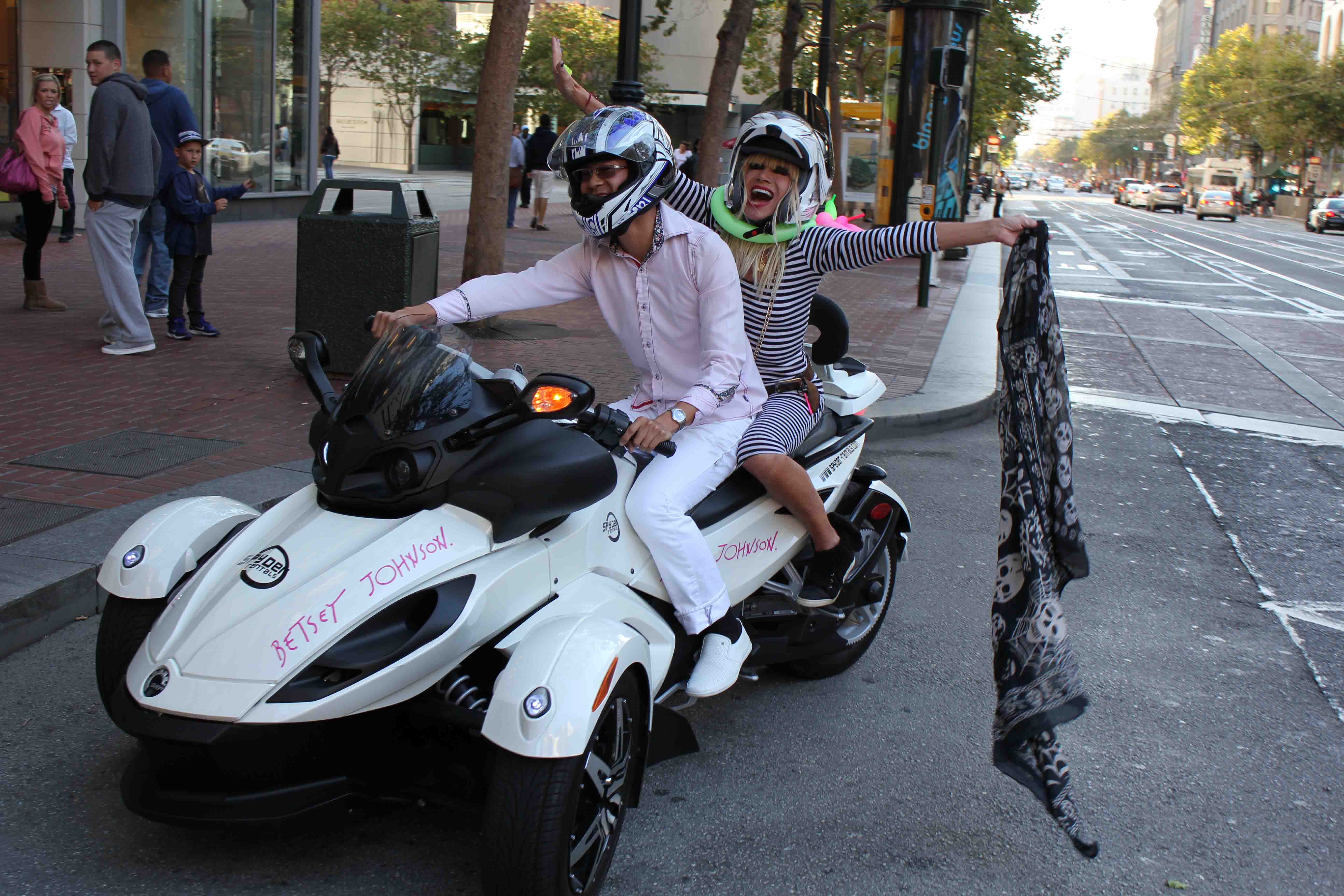 Spyder rentals com driving betsey johnson on the back of a custom can am spyderbetsey arriving at an undisclosed location on a can am spyder provided by