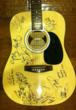 Acoustic guitar autographed by Chuck Allen Floyd, Miss Leslie, Mark Chesnutt, Shake Russell, The Trisha's, Micky Braun, Shelly Coley, Ezra Charles, Charlie Robison, and Kevin Welch.
