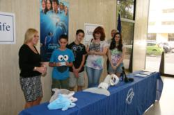Travis Simpson and his family are presented tickets to the Clearwater premier of Dolphin Tale.