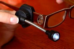 The Eyeglass Light attaches to nearly any eyeglass or safety glass frame and weighs only .7 ounces