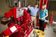 An FM Global instructor reviews components of a fire pump with an FM Global engineer.