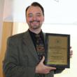 J. Kevin Smith accepts a 2011 Gold CQIA Innovation Prize for Scene Partner