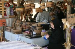 A local Amish basketweaver sells her wares at the Shipshewana Fall Crafters Fair.
