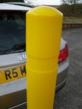 Model R-8351 yellow, flexible bollard withstands low impact from car bumper