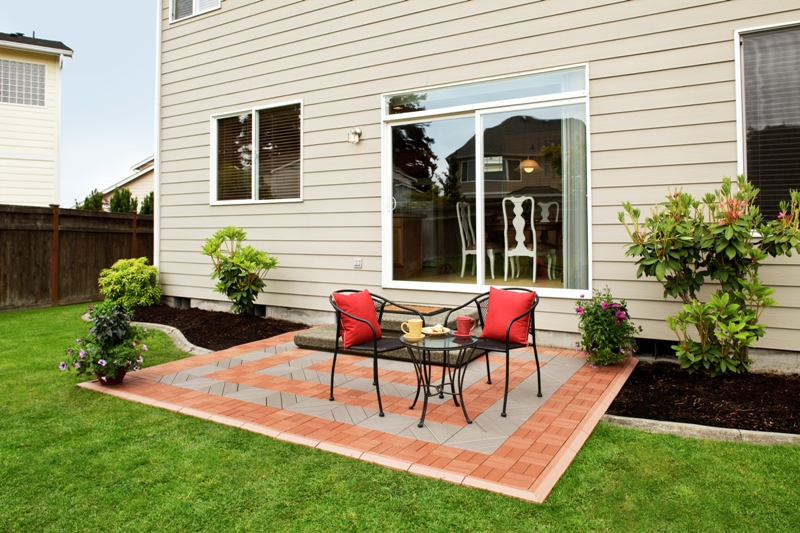 Backyard Patio Tiles : EcoShield? Deck Tiles enhance a concrete slab patio A combination of