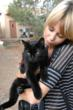 Paul Mitchell Schools Future Professional cuddles cat at Best Friends Animal Sanctuary