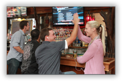 Sports bar customers are using their Smartphones to listen to muted televisions.