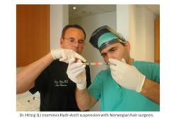 Dr. Hitzig examines Hydr-ACell suspension with Norwegian hair surgeon.