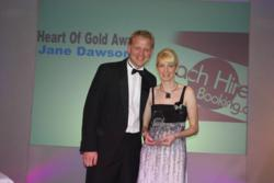 Steve Turner presents Jane Dawson with her 'Heart of Gold' award.