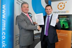 David Williams of RMS (left), and Jon Woodward of neutrinoBI (right) – having signed the partnership agreement.