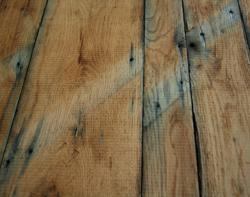 The reclaimed oak sub-flooring shows its character and beauty.