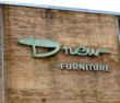 The exterior of the factory still holds an original Drew Furniture sign and logo.