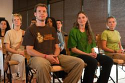 "Participants learning a powerful 21-minute yogic kriya crafted specifically to engineer one's own ""inner climate."""