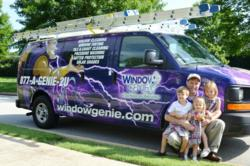 Ben Hankins and his family, Window Genie Northwest Georgia, stand next to the eye-catching Geniemobile
