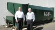 Bob Boucher of EOMS Recycling and Braintree Printing's Jim Corliss in front of the printing company's new 35-yard compactor unit.