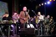 Either/Orchestra leader Russ Gershon (center) with band members and alumni (from left) John Carlson, Rafael Alcala, Dan Fox, Josh Roseman, Miguel Zenon, Hailey Niswanger, Charlie Kohlhase and Kurtis Rivers.