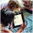 Children collaborating on a drawing in Pirate Scribblebeard's Treasure