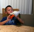 A student makes music with the RAFT Glove-a-phone Activity Kit