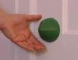 Thumbby™ Soft Massage Cone on door