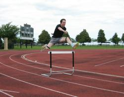 Man wearing F-Scan Datalogger jumping hurdle