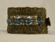 cuff of faceted London Blue Topaz on antique French braid