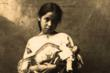 Historic photo of Lakota Girl with doll Denver Public Library