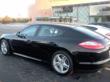 Car wash franchise steam cleaning a Porsche