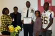 Courage Award winner, officer Anthony Starks with his family at the West Tennessee Detention Facility, Mason, Tenn.