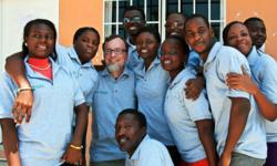 QuickStart Intelligence Instructor, Mark Wheatley with the students in Haiti