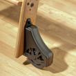 """Ladder glides easily over flooring with its 4"""", easy glide wheel housings."""