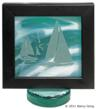 Nautical themed carved glass by Nancy Gong captures the scene of a beautiful day on emerald waters.