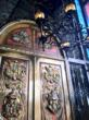 custom handcarved wood doors with wrought iron and blown glass chandelier at No Mas!