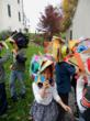 First graders in bird masks line up for the Westtown Lower School Halloween parade