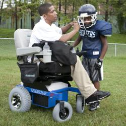 Coach Sonny uses his Hoveround to stay in the game