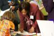 The Deputy Ambassador from Malawai labels her country on the map of Africa for a 3rd grade student during Oneness-Family School's annual United Nations Day.