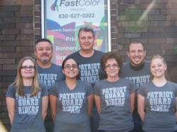 "Members of the Fast Color Print team proudly wear the newly designed ""Mission Shirts.""  The sale of the shirts will directly benefit the Patriot Guard Riders' ""Help on the Homefront"" mission, which provides emotional and financial assistance for wounded soldiers and veterans."