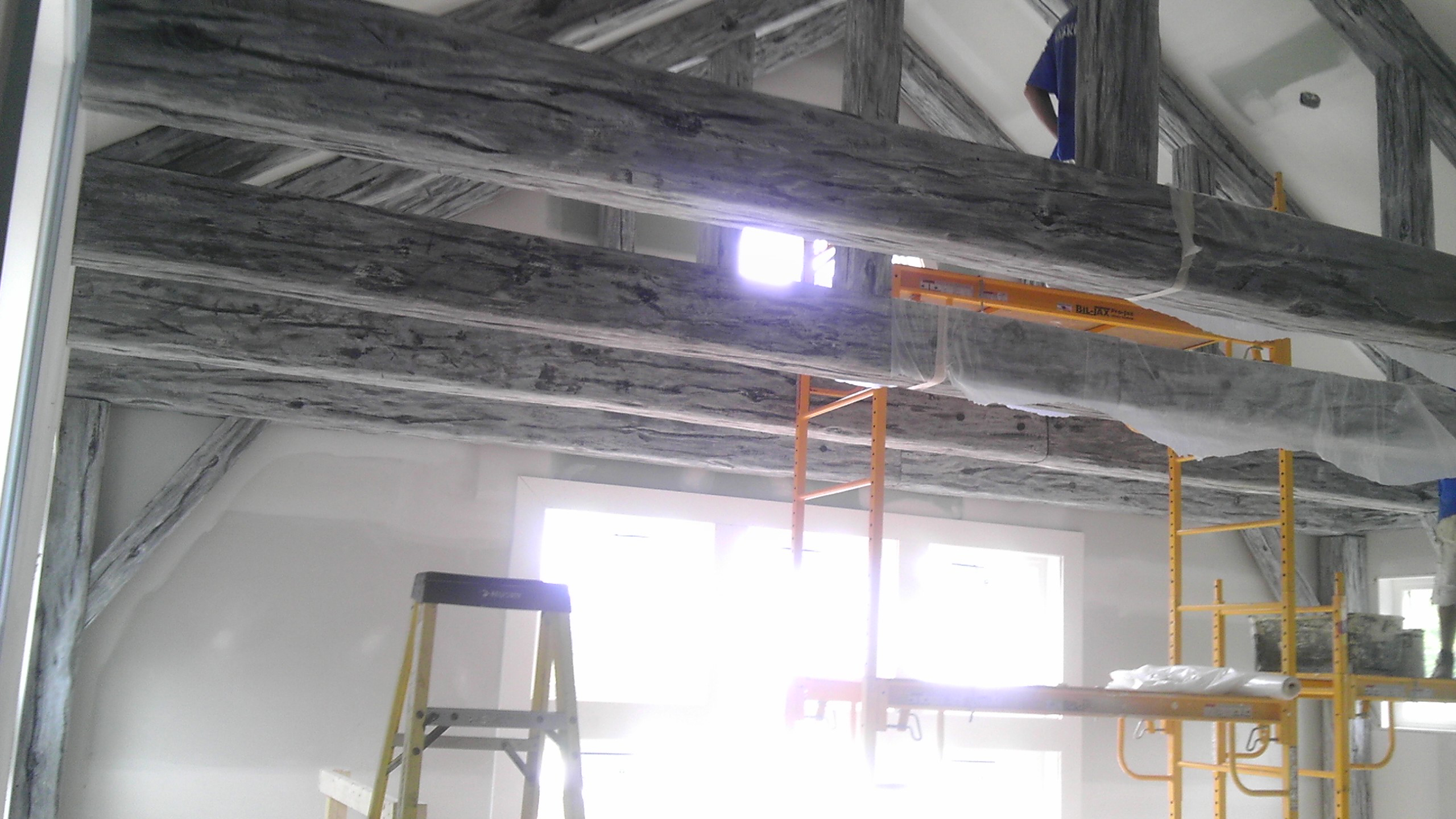 Extreme makeover home edition uses faux ceiling beams for Faux wood trusses