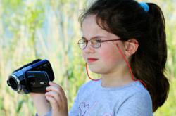 Little girl holding camcorder
