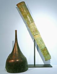 A 9th century BC Neo-Assyrian inscribed bronze quiver and bimetallic helmet