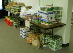 Over 1,000 pounds of food was collected by Page 1 Solutions to benefit the Jeffco Action Center