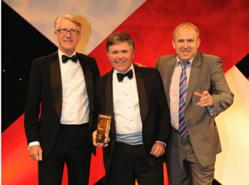 Tim Anstee (centre) receiving the prestigious award for Best Long Term Care Intermediary with Chris Horlick, Managing Director of Care at Partnership (left) and celebrity comic, Tim Vine (right).