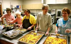 Meals on Wheels volunteer servers at Two Rivers Senior Center