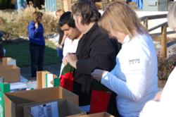 Employees of Mattress Safe, Inc. filling stockings for the Troops