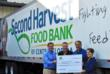 Second Harvest of Central Florida receives PCL's $10,000 donation for holiday meals.