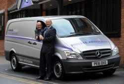Simon Fisher and Stephen Anderson with Midcounties Co-operative Funeral's new zero emission ambulance